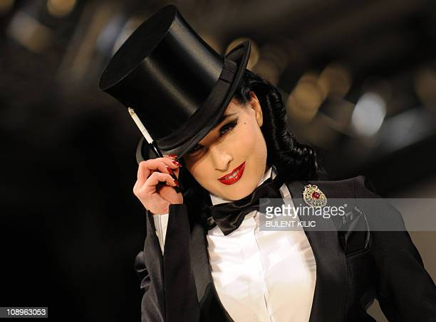 US burlesque artist Dita Von Teese presents a creation by Damat Tween at the Istanbul Fashion Week on February 4 in Istanbul The Istanbul Fashion...