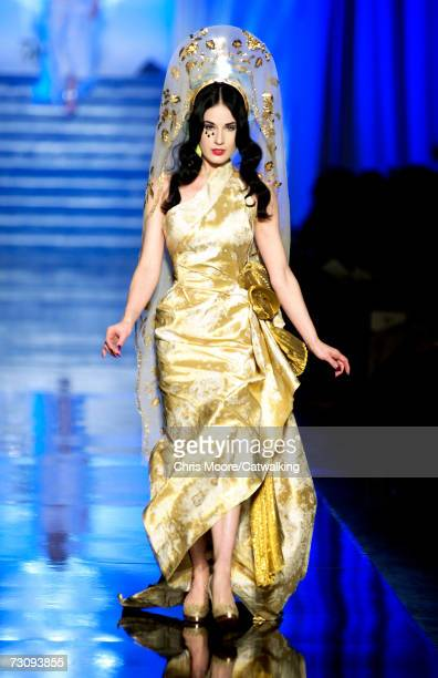 Burlesque artist Dita Von Teese walks down the catwalk during the JeanPaul Gaultier fashion show as part of Spring / Summer 2007 Haute Couture on...