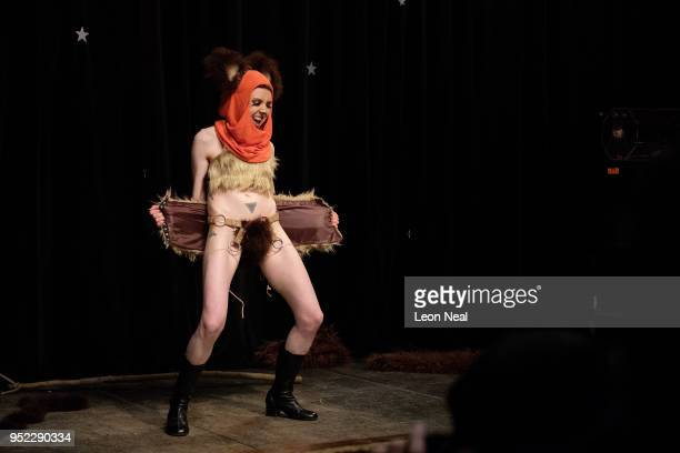 Burlesque dancer Boysinberry Cupcake performs as an Ewok from Star Wras during the opening night of the Nerdlesque Festival on April 27 2018 in New...