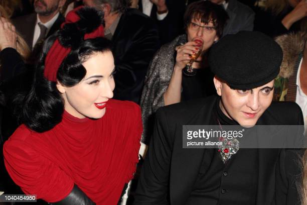US burlesque dancer Dita Von Teese and Ali Mahdavi attend the presentation of Jean Paul Gaultier spring/summer 2015 collection during the Paris Haute...