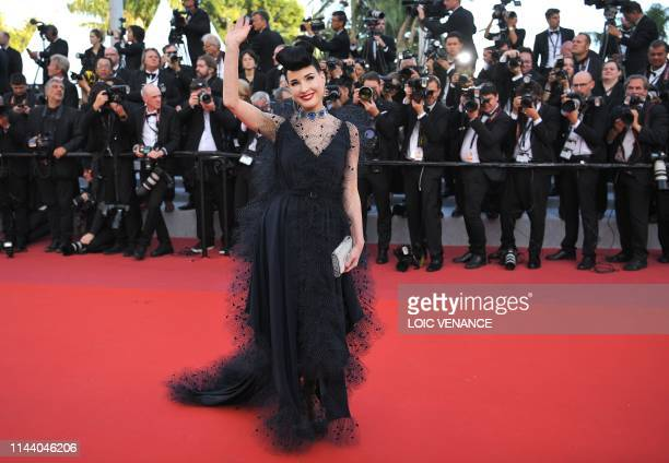 TOPSHOT US burlesque dancer Dita Von Teese waves as she arrives for the screening of the film Rocketman at the 72nd edition of the Cannes Film...