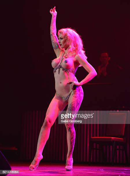 Burlesque dancer LouLou D'vil performs during the Mondays Dark 2nd anniversary at The Joint inside the Hard Rock Hotel Casino on December 14 2015 in...
