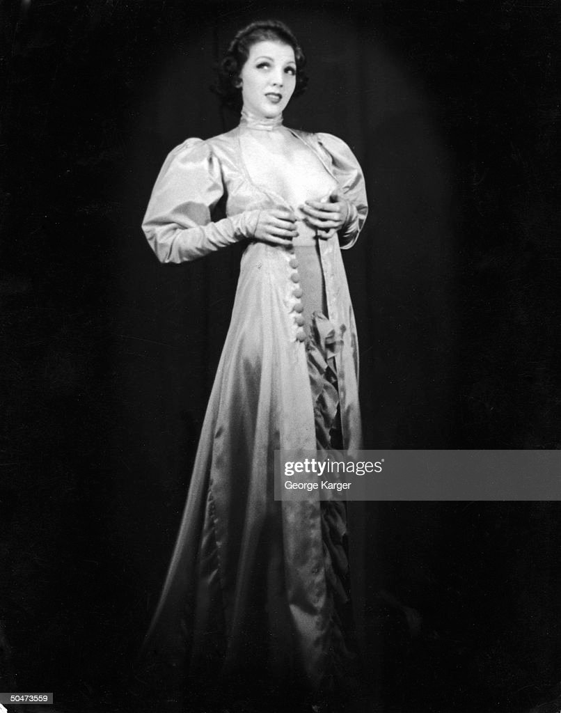 Burlesque dancer Margie Hart baring part of her chest as she performs striptease w. her dress fully open in front, at 42nd St. Apollo Theater.