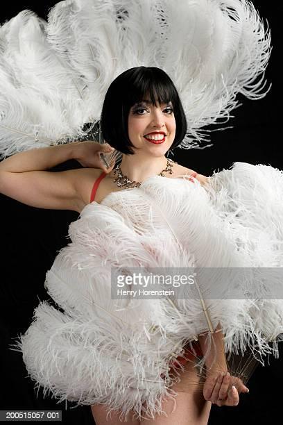 burlesque dancer with feather fans, portrait - feather fan stock-fotos und bilder
