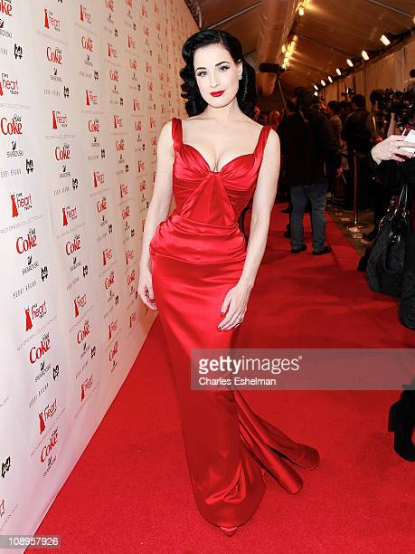 Burlesque Dita Von Teese attends the Heart Truth Fall 2011 fashion show during MercedesBenz Fashion Week at The Theatre at Lincoln Center on February...