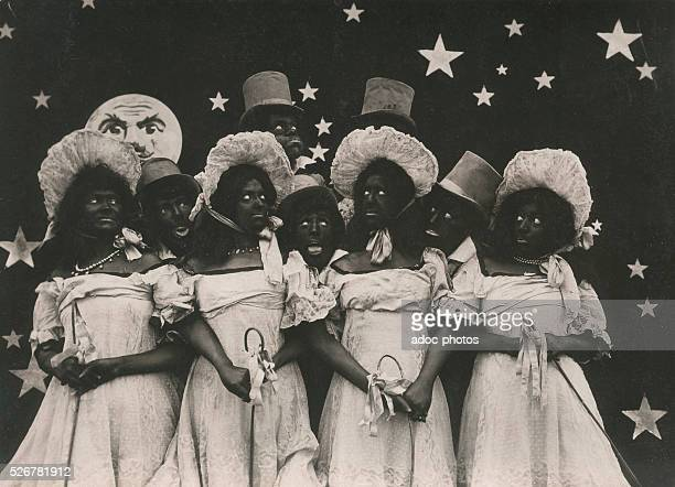 Burlesque film scene Characters disguised as black Ca 1910