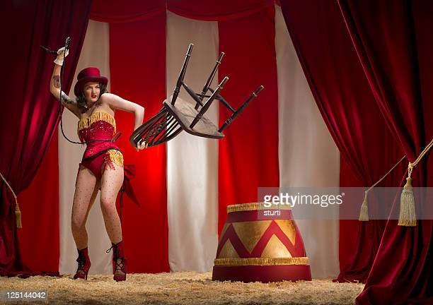 burlesque liontamer - women with whips stock pictures, royalty-free photos & images