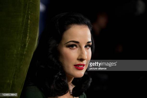 Burlesque model Dita von Teese poses for the camera within a newly renovated Karstadt shop in Duesseldorf Germany 04 September 2013 The chain of...