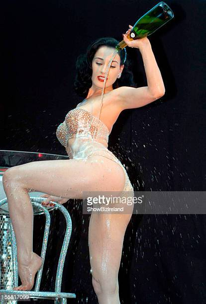 Burlesque performance artist Dita Von Teese gives her Champagne Glass Performance for the launch of Harvey Nichols in the Dundrum Town Centre Dublin...