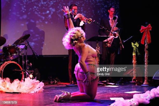 Burlesque performer Dirty Martini performs at Martinis N' Mistletoe presented by the New York Burlesque festival at Le Poisson Rouge on December 22...