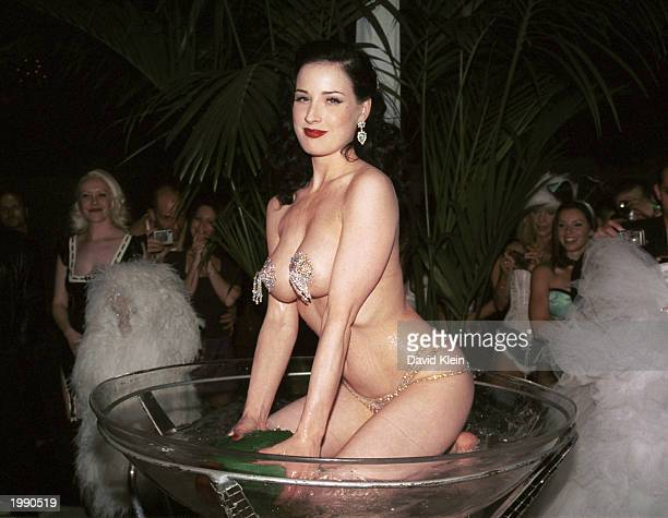 Burlesque performer Dita Von Teese performs her martini dance during the Dewar's 12 Playboy Lounge Tour featuring Von Teese Playmate of the Year...