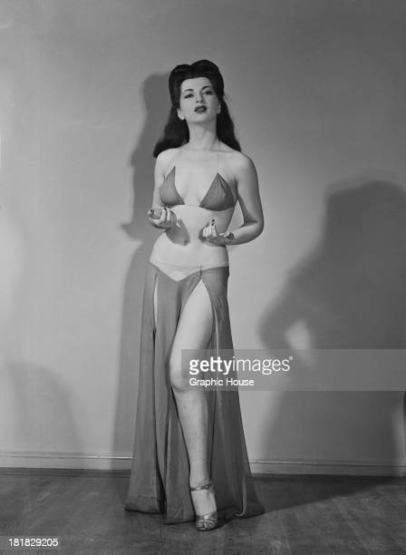 A burlesque performer in a twopiece stage costume circa 1945
