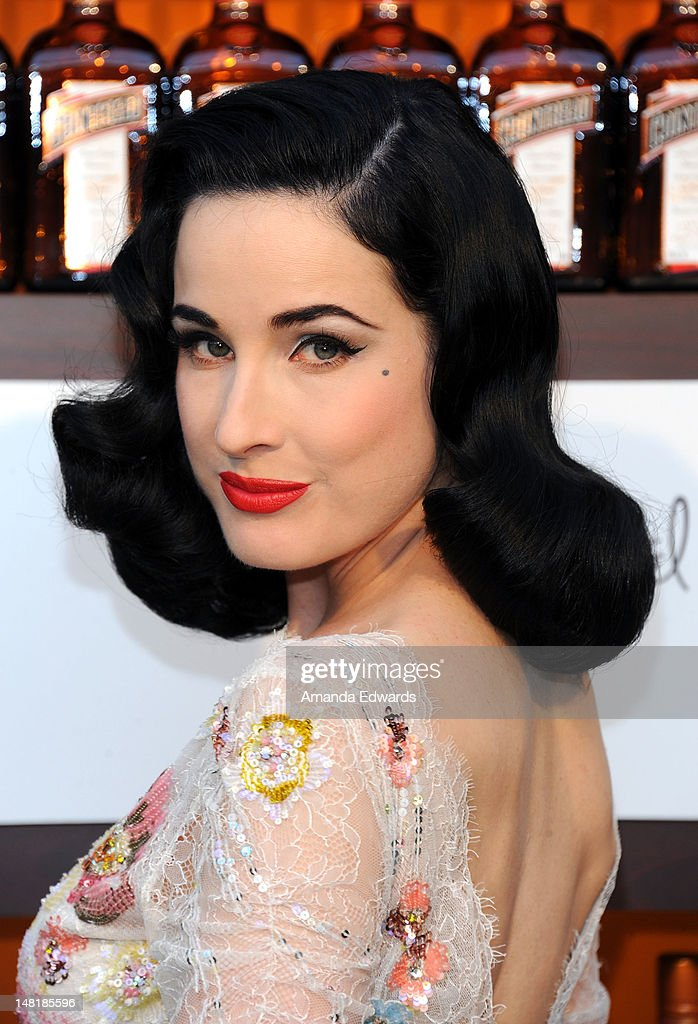 Burlesque star Dita Von Teese arrives at the Dita Von Teese and Cointreau Launch Cointreau Poolside Soirees event at the Beverly Hills Hotel on July 11, 2012 in Beverly Hills, California.