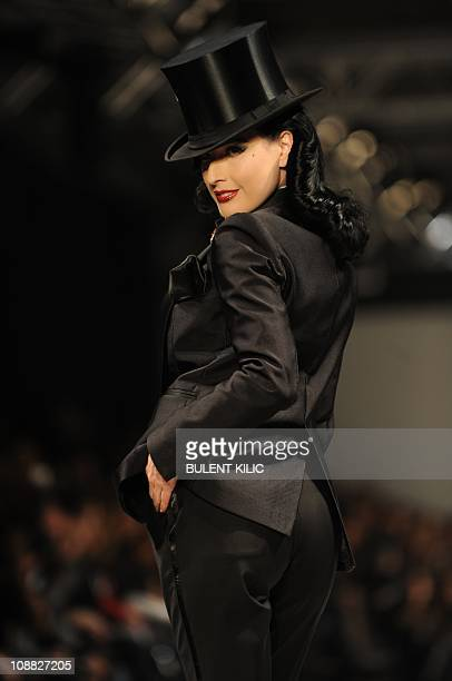 US burlesque star Dita Von Teese presents a creation by Damat Tween at the Istanbul Fashion Week on February 4 in Istanbul The Istanbul Fashion Week...