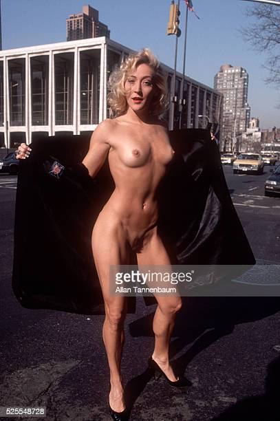 Burlesque stripper and X magazine centerfold girl Melinda Mack flashes outside Lincoln Center to focus attention on the problems of the US economy...