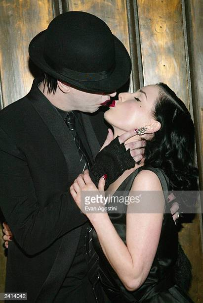Burlesque superstar Dita Von Teese and boyfriend Marilyn Manson arrive at Show, where Von Teese is to perform her striptease August 20, 2003 in New...