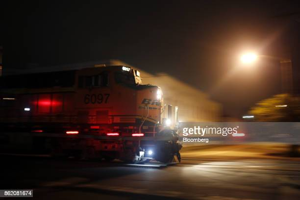 A Burlington Northern Santa Fe LLC locomotive leads a CSX Corp freight train in Louisville Kentucky US on Wednesday Oct 11 2017 CSX is scheduled to...