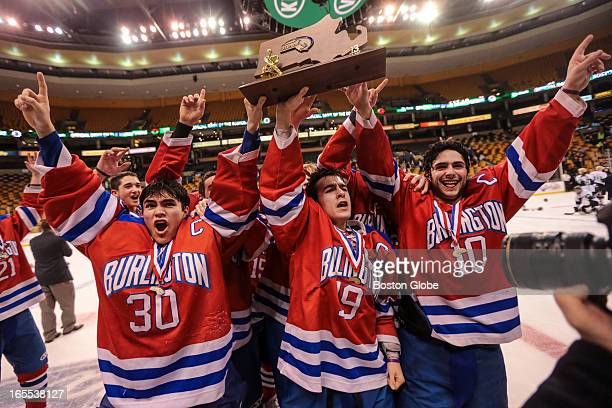 Burlington players celebrate their win following a game between Burlington and Marshfield at the MIAA High School Hockey Championships held at the TD...