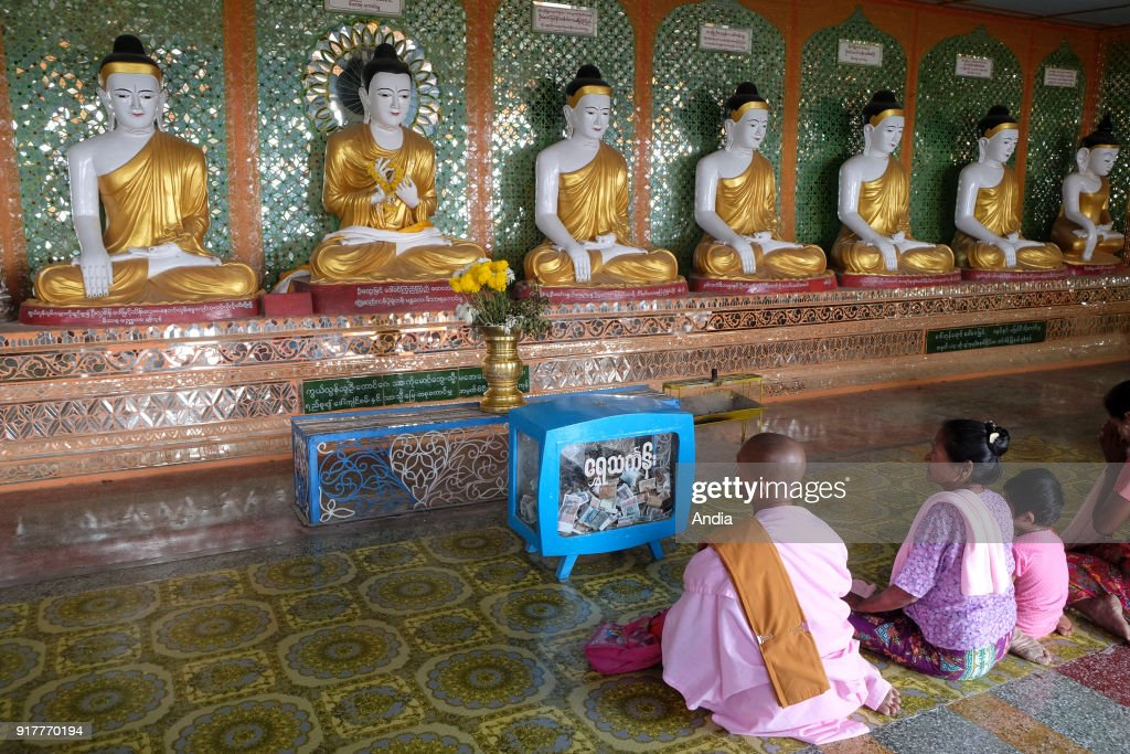 family praying in the pagoda of Umin Thounzeh, Sagaing Hill.