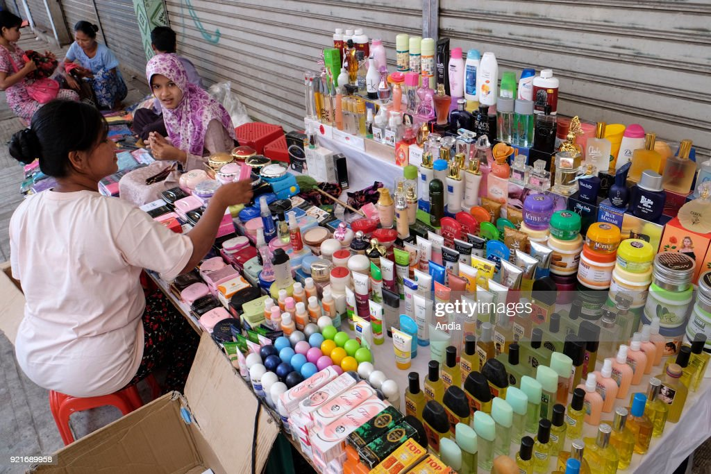 peddler selling beauty products in a street of Rangoon.