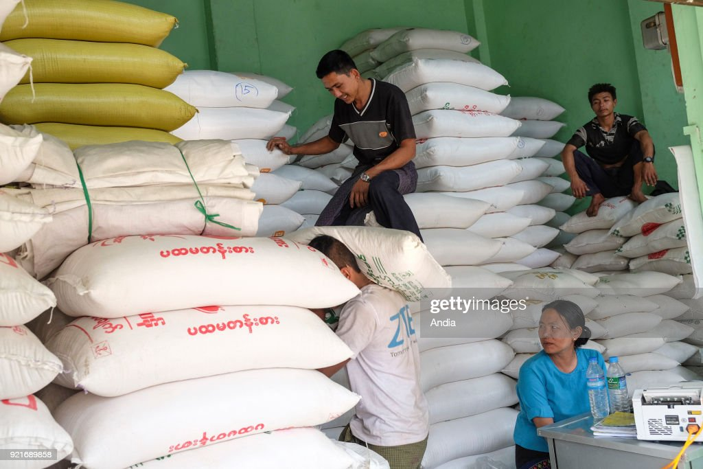 unloading of rice bags in front of a stall at Shan Market.