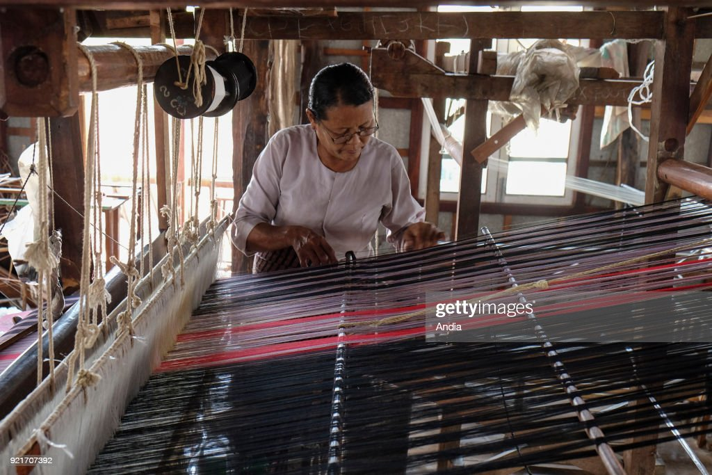 weaving workshop in the village of Inn Paw Khone, Inle Lake. Woman working in front of a weaving loom.