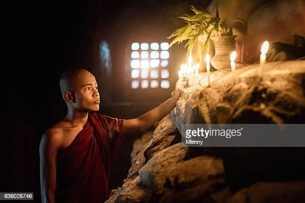 Burma Novice Monk Lighting Temple Candles to Worship Buddha Myanmar