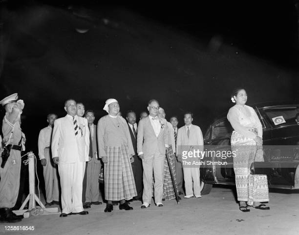 Burma Prime Minister U Nu and his wife Mya Yi are seen off by Japanese Foreign Minister Mamoru Shigemitsu on departure at Haneda Airport on July 23,...