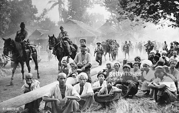 BurmaNatives gathered by the roadside in the town of Maltaban in Burma to watch the invading Japanese march through on their way to Rangoon suddenly...