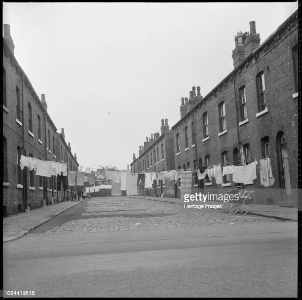 Burmantofts Leeds West Yorkshire 19661974 Washing hanging between back to back houses in Westlock Terrace or Westlock Crescent with a Burton emblem...