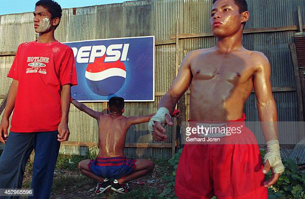 Burmese boxers get prepared for their bareknuckle fights in a boxing ring at an amusement park in Mae Sot Children fight for as little as 300 baht...