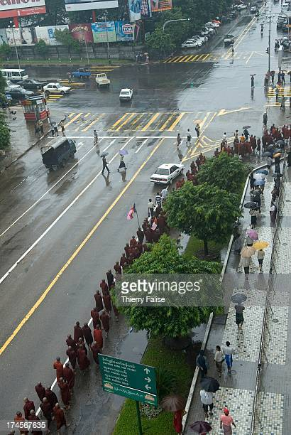 Burmese Buddhist monks protesting against the military junta march towards the Sule pagoda one of the most popular in Rangoon