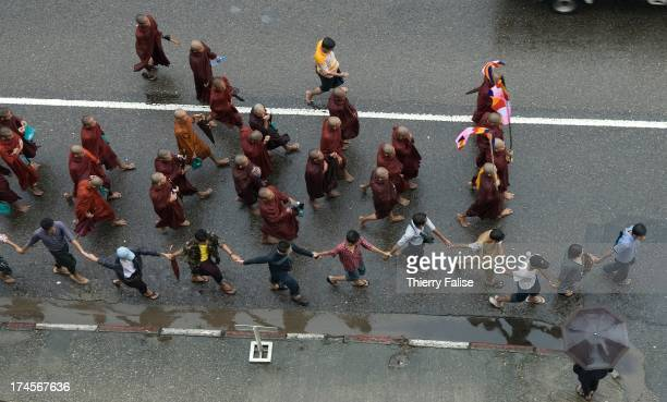 Burmese Buddhist monks protesting against the military junta march towards the Sule pagoda, one of the most popular in Rangoon..