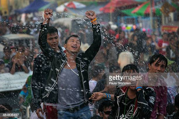 Burmese celebrate the second day of their new year water festival called Thingyan April 14 2014 in Yangon Myanmar Waterthrowing is the distinguishing...