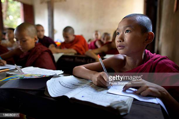 Burmese children and monks study together at a school run by a monastery December 15 2011 in Bago Myanmar The education system is based on the United...