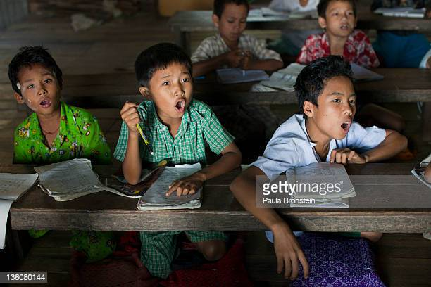 Burmese children attend classes at a government run school December 14 2011 in Waw township Myanmar The education system is based on the United...