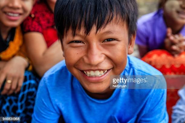 burmese children having fun in temple, old bagan, myanmar - myanmar stock pictures, royalty-free photos & images