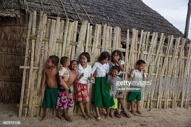 Burmese children laugh in their village near the planned Dawei SEZ on August 3 2015 in Pantininn Myanmar The controversial multibillion dollar Dawei...