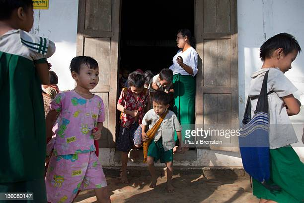 Burmese children leave school after classes are over at a government run school December 14 2011 in Waw township Myanmar The education system is...