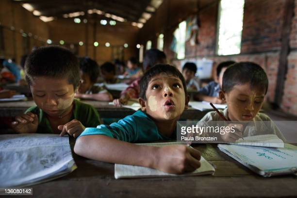 Burmese children listen during class at a government run school December 14 2011 in Waw township Myanmar The education system is based on the United...