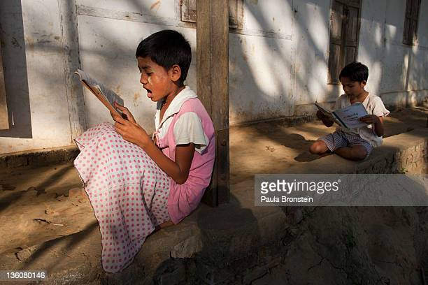 Burmese children read after class at a government run school December 14 2011 in Waw township Myanmar The education system is based on the United...