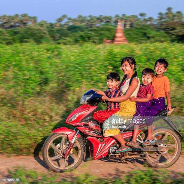Burmese children riding motorbike, Bagan, Myanmar