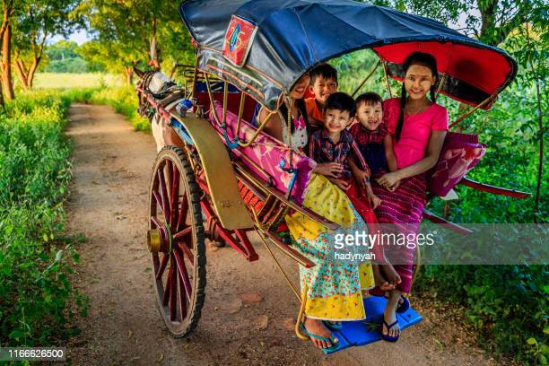 burmese children sitting on a horse cart, bagan, myanmar - indochina stock pictures, royalty-free photos & images