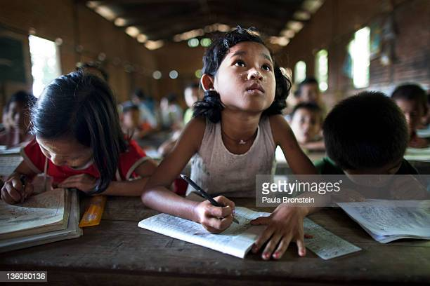 Burmese children study during class at a government run school December 14 2011 in Waw township Myanmar The education system is based on the United...