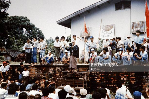 A Burmese demonstrator calling over a loud hailer addresses hundreds of thousand of antigovernment protestors most of them students on August 18 who...
