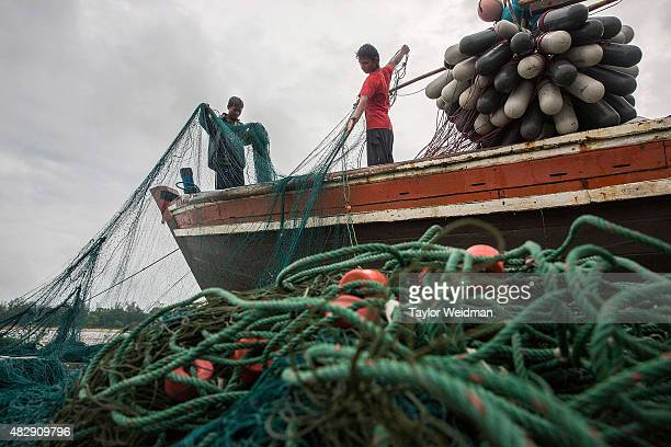 Burmese fishermen prepare their nets before a voyage near the planned Dawei SEZ on August 2 2015 Bawar Village Myanmar The controversial multibillion...