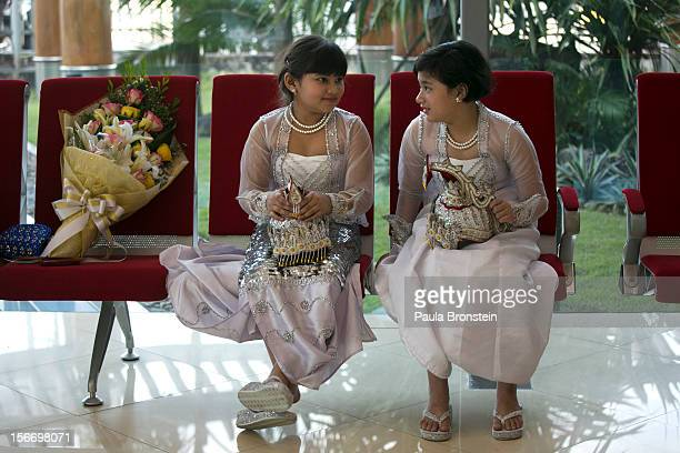 Burmese girls wait to greet US President Barack Obama as he arrives at Yangon International airport during his historical first visit to the country...