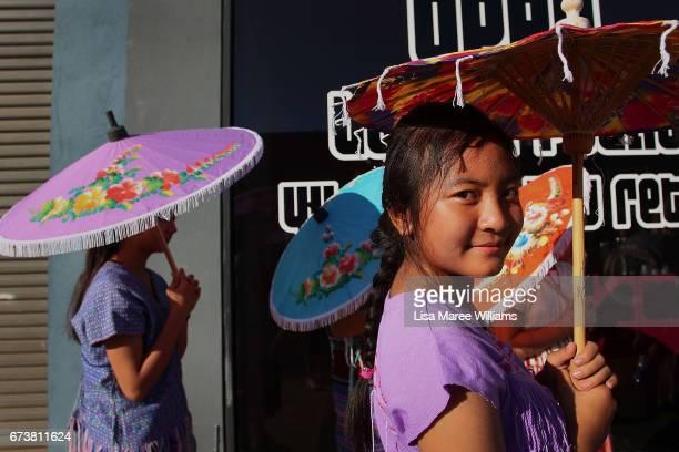 Burmese Karenni Byaw Ku Gay shades herself from the sun under a umbrella on Peel Street on January 28 2017 in Tamworth Australia Tamworth is a large...