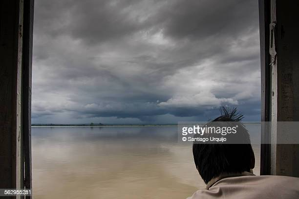 Burmese man looking to a monsoon storm