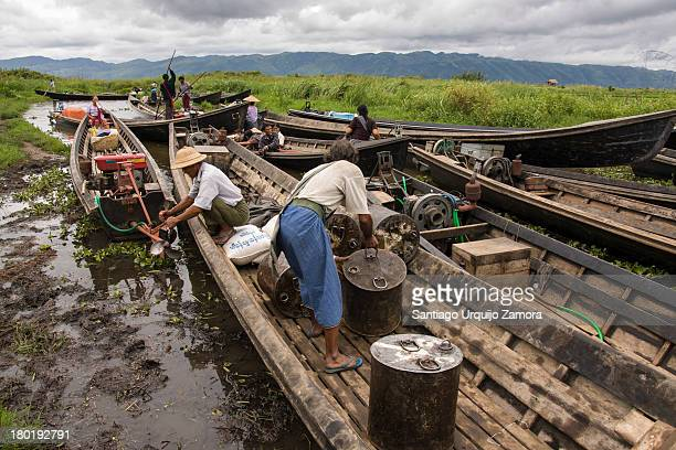 CONTENT] Burmese men loading their wooden pirogues after the early morning market in Maing Thauk Inle Lake Shan State Myanmar There is a rotating...